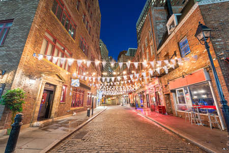 Stone Street, New York City, USA restaurant district at night.