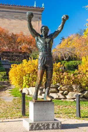 PHILADELPHIA, PENNSYLVANIA - NOVEMBR 16, 2016: The Rocky Balboa statue during autumn. The statue commemorates the The Rocky film series which has become a cultural icon.