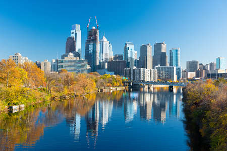 Philadelphia, Pennsylvania, USA downtown skyline on the river in autumn.