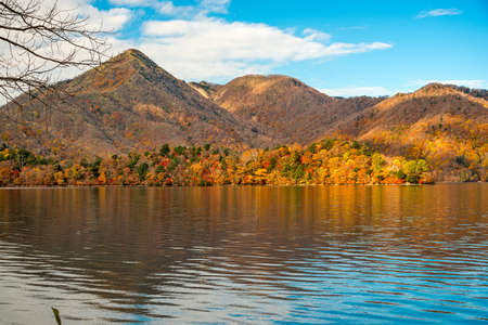 Fall foliage on the Mountains around Lake Chuzenji in Nikko, Japan.