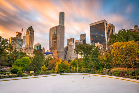 New York, New York, USA cityscape from Central Park in autumn.