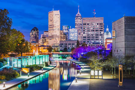Indianapolis, Indiana, USA skyline and canal at dusk in autumn.