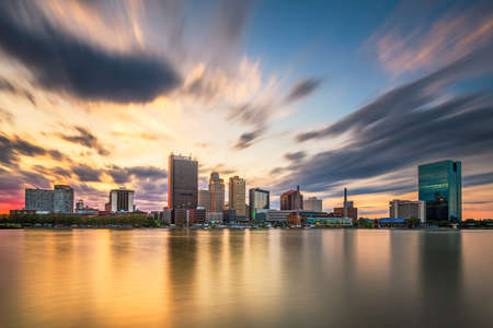Toledo, Ohio, USA downtown skyline on the Maumee River at dusk.