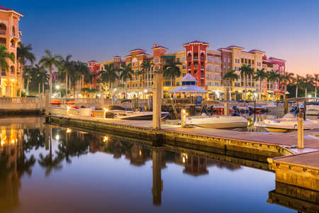 Naples, Florida, USA downtown cityscape on the bay at dusk.