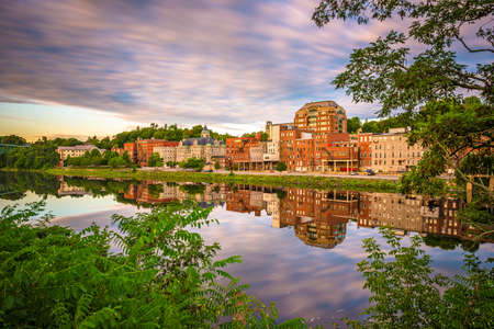 Augusta, Maine, USA skyline on the Kennebec River in the morning.