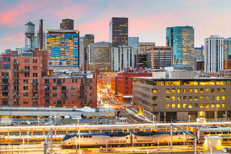 Denver, Colorado, USA downtown cityscape over the train station at twilight. Stock Photo