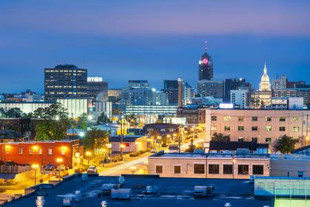 Lansing, Michigan, USA downtown city skyline at twilight.