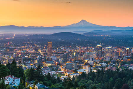 Portland, Oregon, USA skyline at dusk with Mt. Hood in the distance. Stock Photo