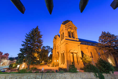 Cathedral Basilica of St. Francis of Assisi in Santa Fe, New Mexico, USA at twilight.