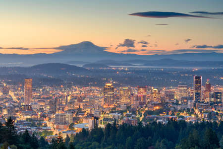 Portland, Oregon, USA downtown skyline with Mt. Hood at dawn.