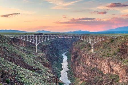 Taos, New Mexico, USA at Rio Grande Gorge Bridge over the Rio Grande at dusk.