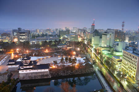 Toyama, Japan downtown city skyline at twilight over the castle. 版權商用圖片