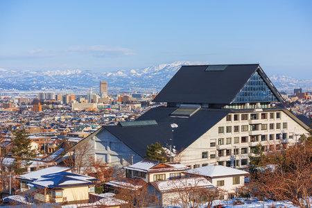 Yamagata City, Japan skyline with mountains.