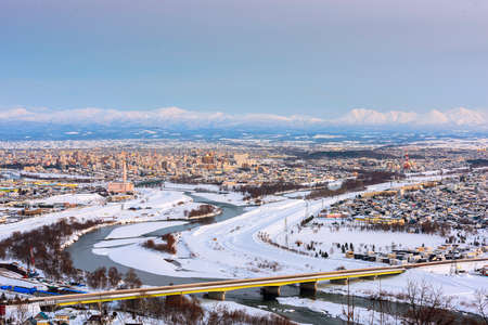 Asahikawa, Japan twilight winter cityscape in Hokkaido.
