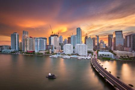 Miami, Florida, USA skyline over Biscayne Bay at dusk.