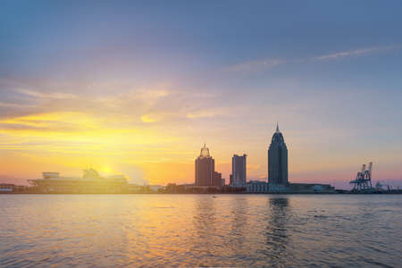 Mobile, Alabama, USA downtown skyline  on the river at sunset.