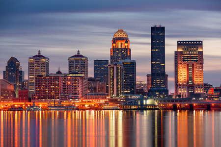 Louisville, Kentucky, USA skyline on the Ohio River at night.