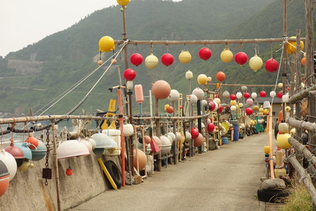 Street decorated with buoys by the local fishermen