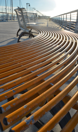 sinuous: Bench on the boardwalk Stock Photo