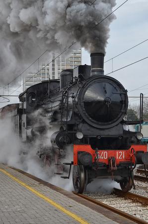 Classic train in clouds of smoke