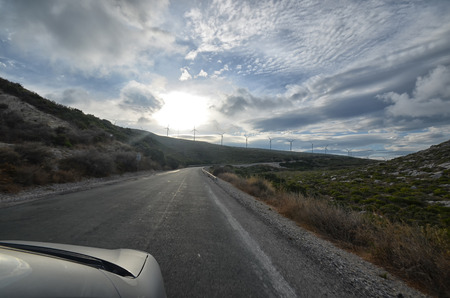 View of wind turbines from inside the car photo
