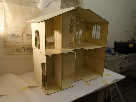 View of a dollhouse and drawings of the project