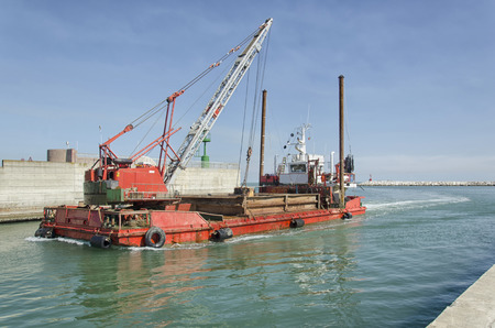 dredger: View of a dredger coming into port Stock Photo