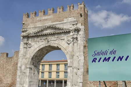 augustus: Arch of Augustus in Rimini with sign of greetings Stock Photo