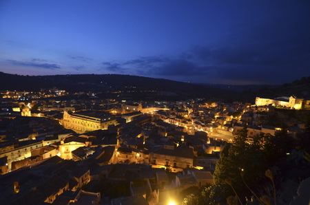 scenical: View of the town of Scicli at sunset