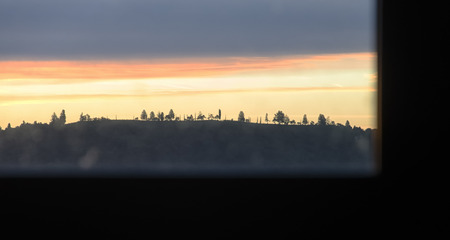 quietude: Dawn view from a window in a park