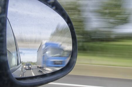 rearview: Overtaking a truck seen in the rearview mirror