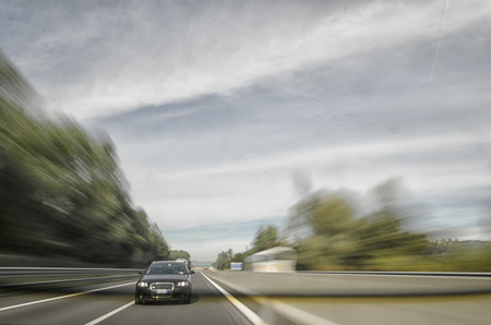 overtaking: Car getting ready to overtake on the highway Stock Photo