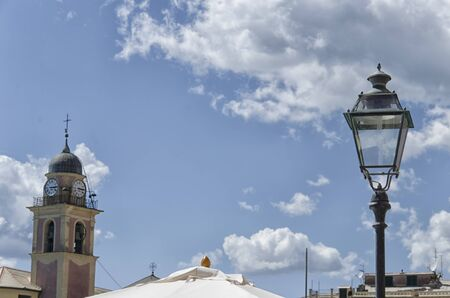 bell tower: Lamp and bell tower on a sunny day