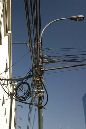 wire mess: Chaotic interlacement of electric cables in Valparaiso Stock Photo