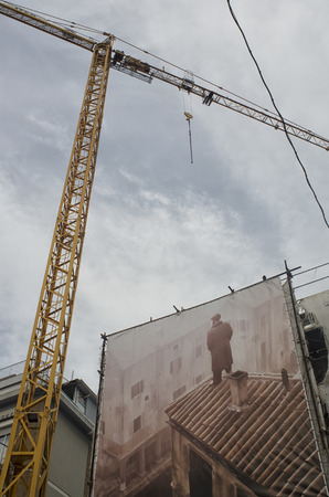 the mural: View of tower crane and mural on canvas