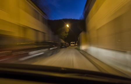 penumbra: Night view of car in narrow street