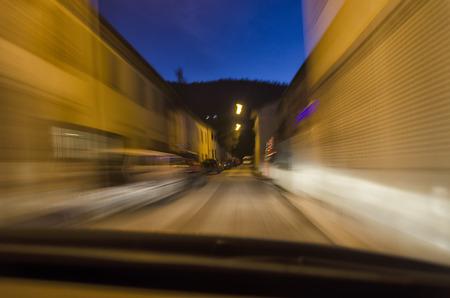 penumbra: Inside view of a car in narrow street