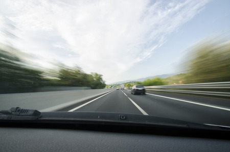 overtaking: View of car overtaking on a motorway Stock Photo