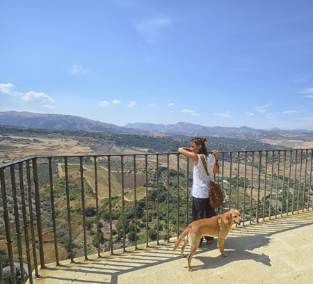 ronda: Woman and her dog at the terrace of Ronda