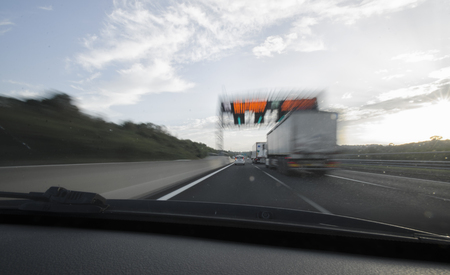 overtake: On board of a car that overtaking on the motorway Stock Photo