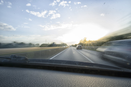 overtaking: Inside view of car that runs fast in motorway