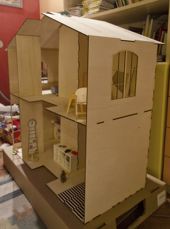 doll house: View of the furnishings of a wooden doll house