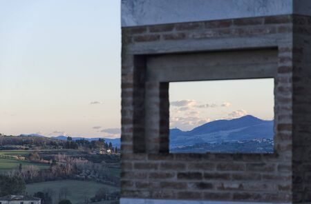 tuscan: Typical Tuscan landscape framed by modern monument Stock Photo