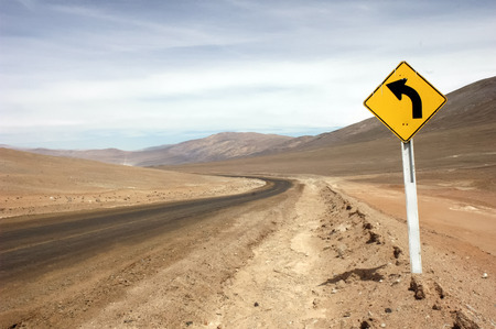 dirt road: Road sign in the desert of Atacama