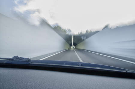 overtaking: View of car that goes faster in a tunnel Stock Photo