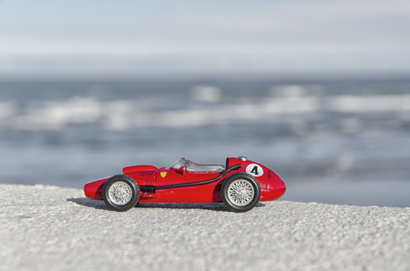 festival scales: View of model of a historical car over the sea