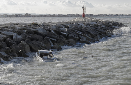 boat accident: Aftermath of a storm in front of the port of Rimini