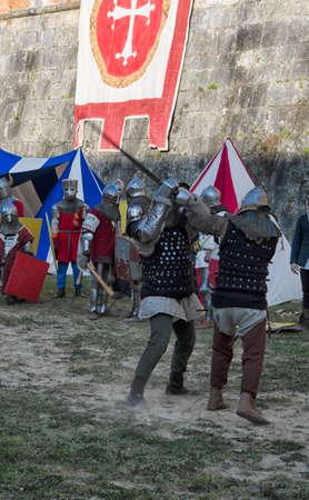 sword fight: Sword fight between knights in historical re-enactment in Pisa