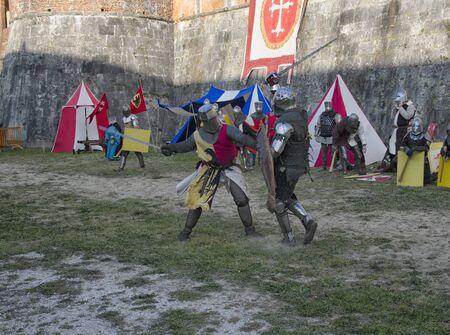 sword fight: Sword fight between knights in medieval fair at Pisa