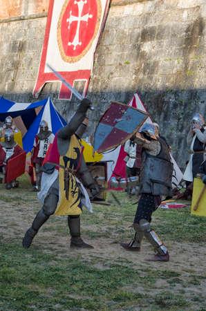 sword fight: Sword fight between knights in medieval fair